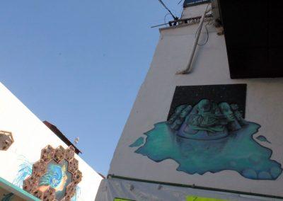 001 Manantial de historias, acrílico y carbon sobre muro, Plaza Real, Xalapa, Veracruz